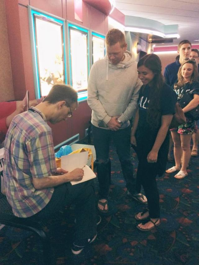 Dave signs books after the Florida screening.